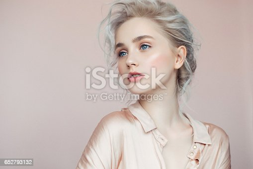 istock Beautiful woman with make-up and stylish hairstyle 652793132