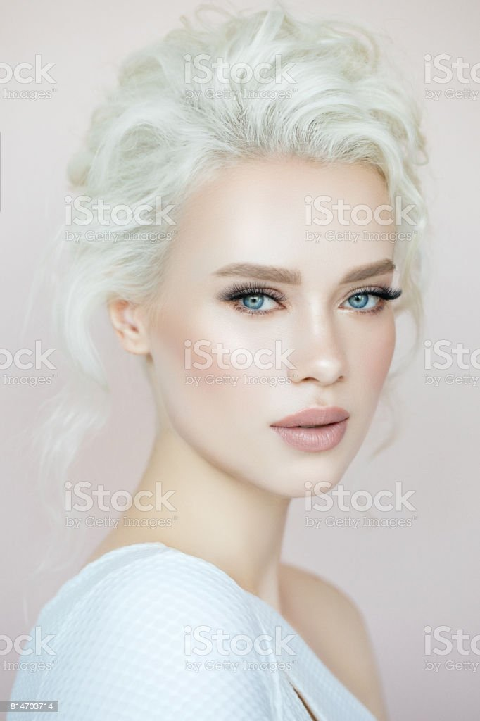 Beautiful woman with make-up and stylish hairstyle stock photo