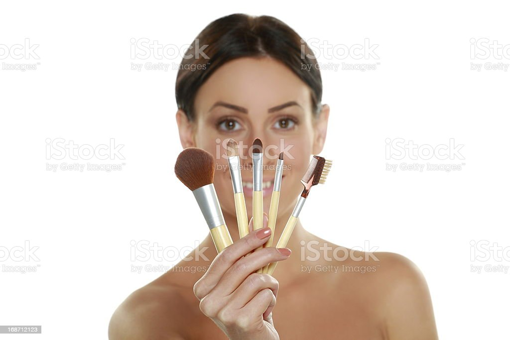 Beautiful woman with makeup brush near her face royalty-free stock photo