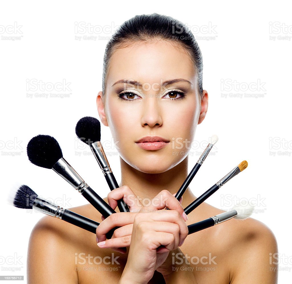 Beautiful woman with makeup brushes royalty-free stock photo