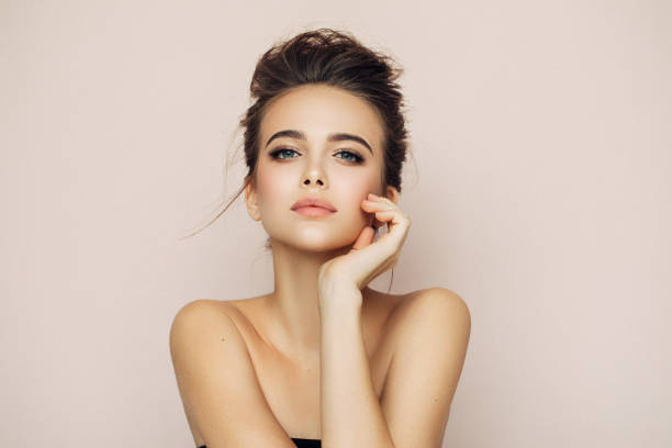 beautiful woman with make-up - beauty treatment stock photos and pictures