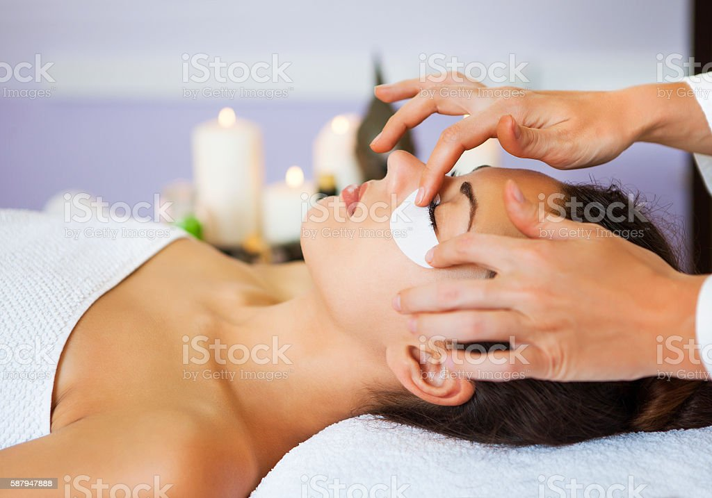 Beautiful woman with mask for eyes at beauty salon stock photo