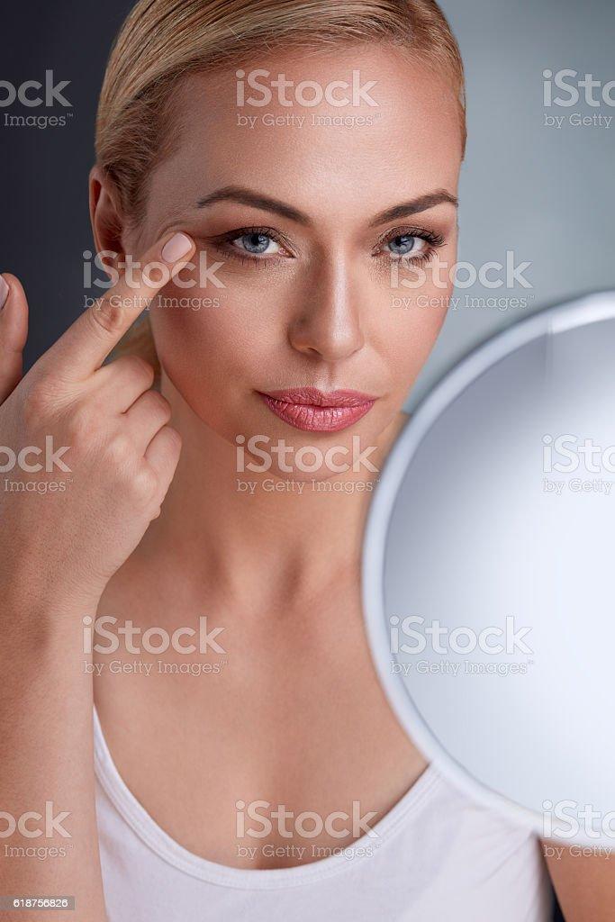 Beautiful woman with mirror stock photo
