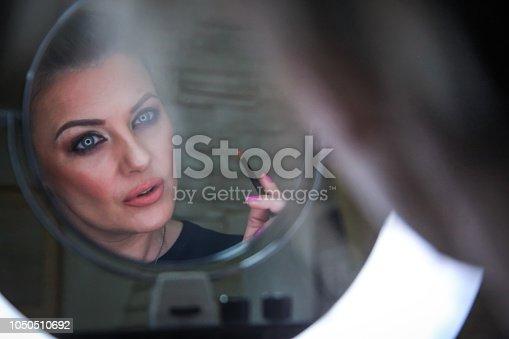 897056188 istock photo Beautiful woman with natural make-up 1050510692