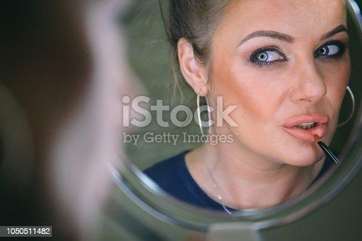 897056188 istock photo Beautiful woman with natural make-up 1050511482