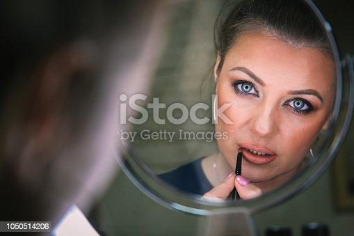 897056188 istock photo Beautiful woman with natural make-up 1050514206
