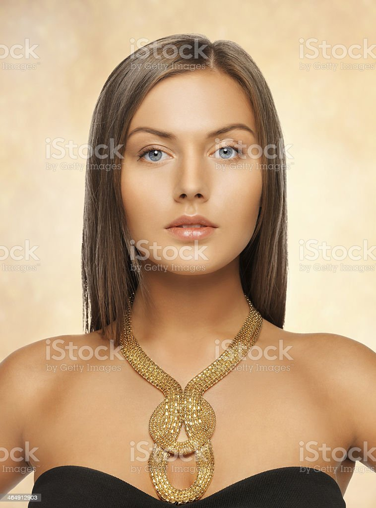 beautiful woman with necklace stock photo