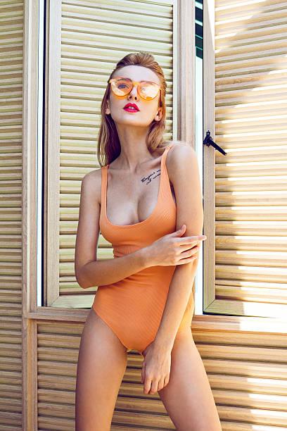 beautiful woman with orange sunglasses - bein make up stock-fotos und bilder