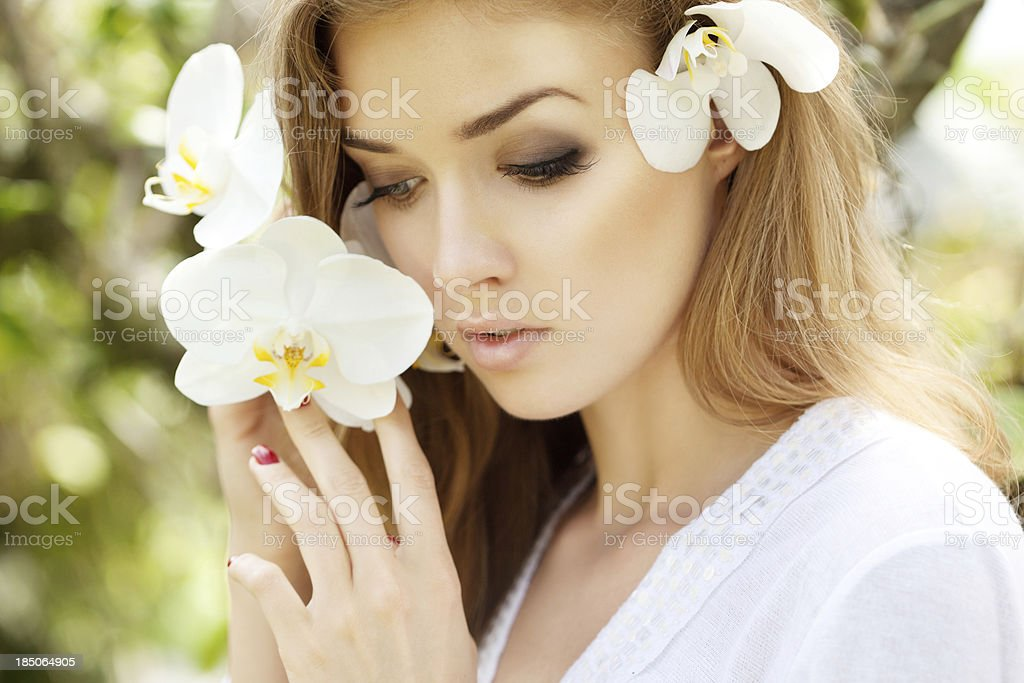 Beautiful woman with orchids royalty-free stock photo
