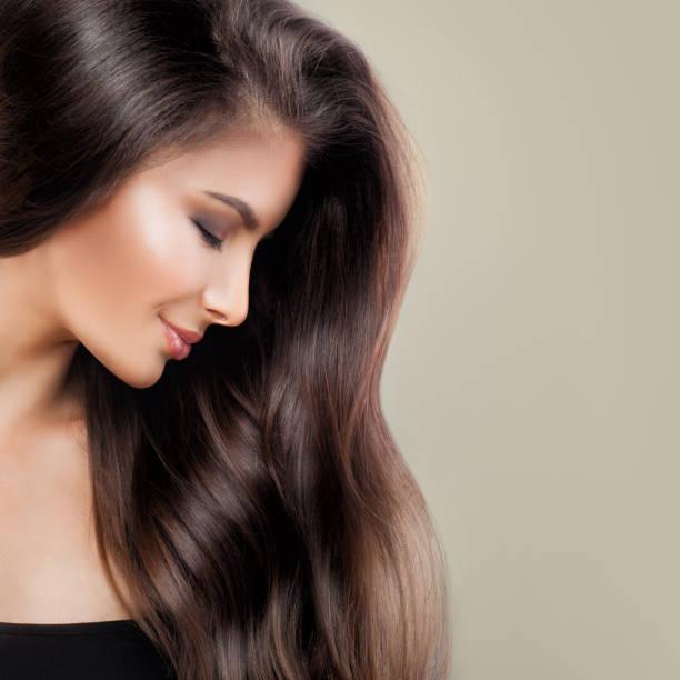 beautiful woman with perfect brown hair and makeup, cute face closeup, profile - capelli castani foto e immagini stock