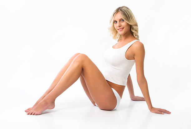 beautiful woman with perfect figure in white underwear - human leg stock photos and pictures