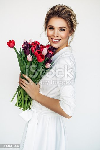 697916070istockphoto Beautiful woman with perfect hairstyle 926802006