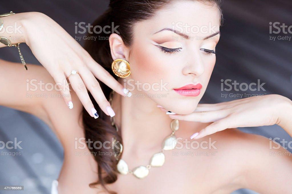 beautiful woman with perfect skin wearing professional make-up royalty-free stock photo
