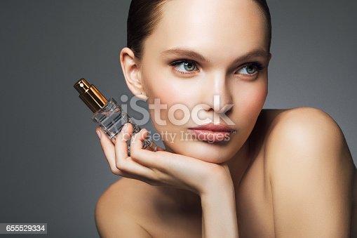 Beautiful woman with perfume