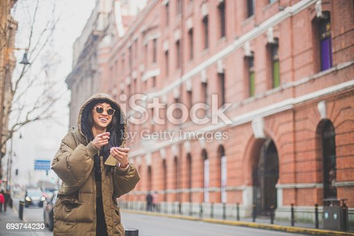 istock Beautiful woman with phone 693744230