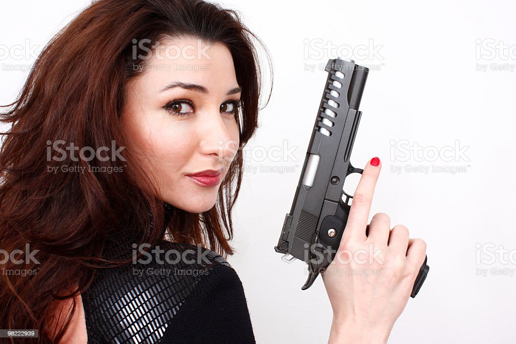 Beautiful woman with pistol royalty-free stock photo