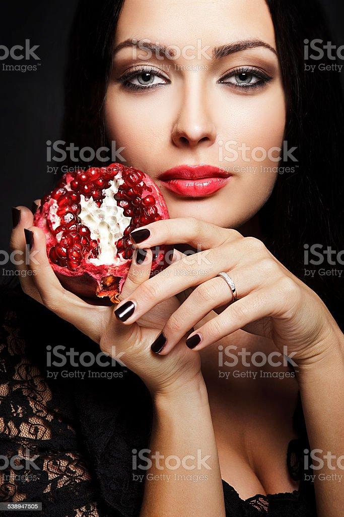 beautiful woman with pomegranate stock photo