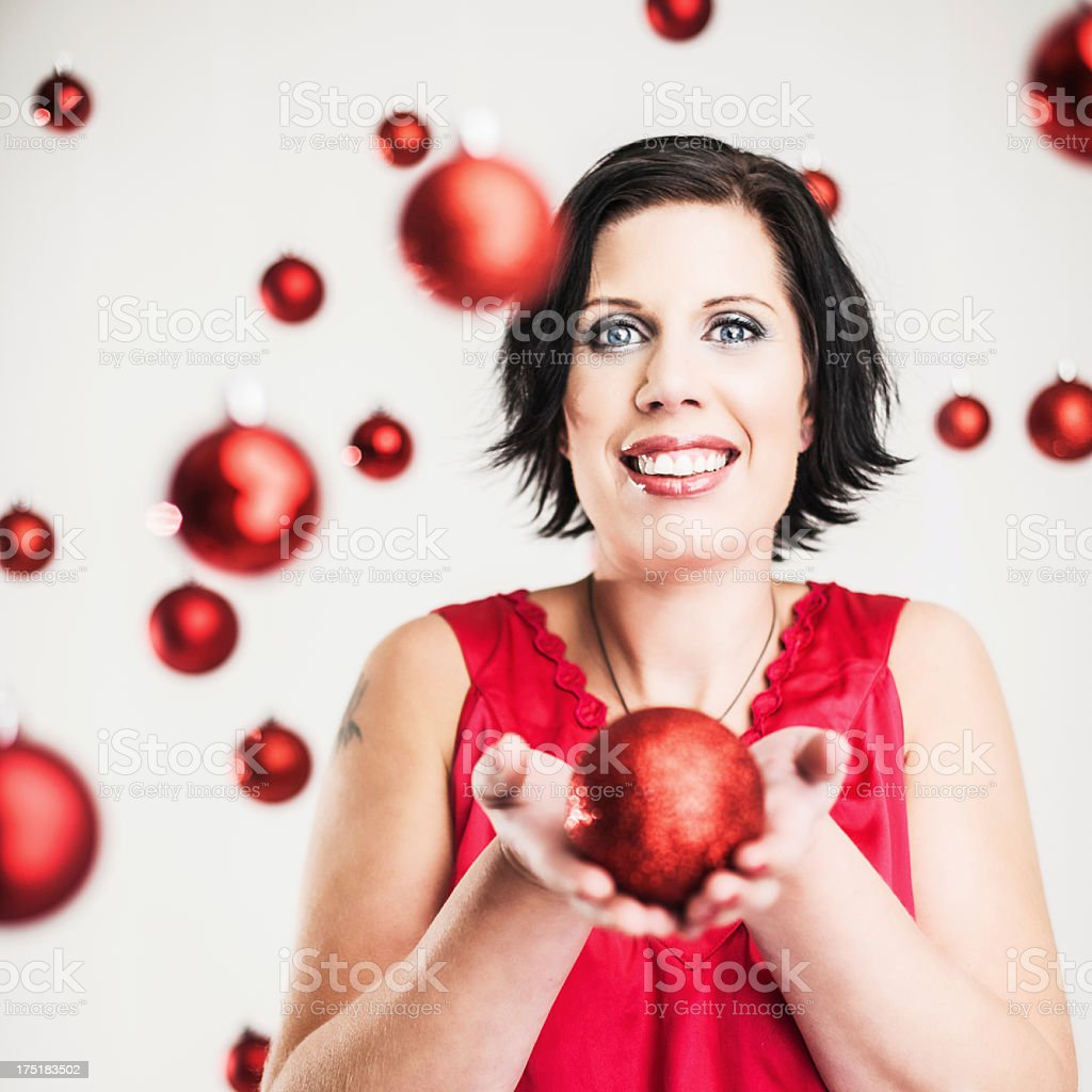 Beautiful woman with red christmas baubles royalty-free stock photo
