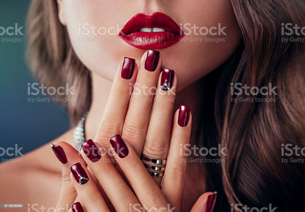 Beautiful woman with red lips and manicure stock photo