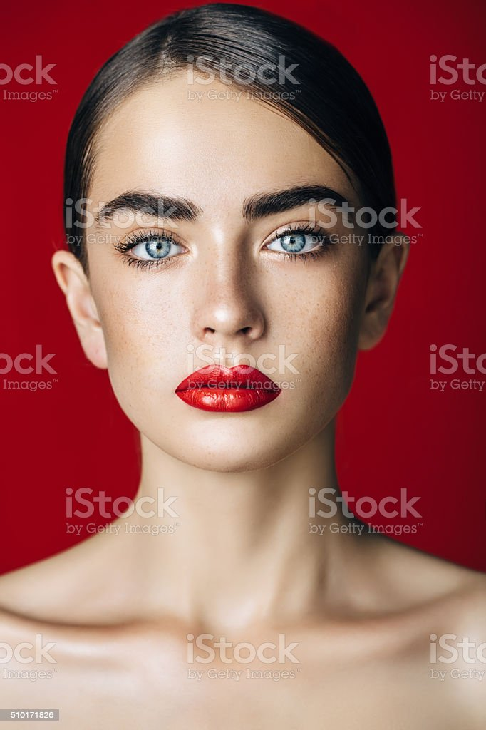 Beautiful woman with red lips stock photo