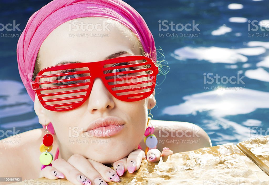 beautiful woman with red sunglasses in the pool royalty-free stock photo