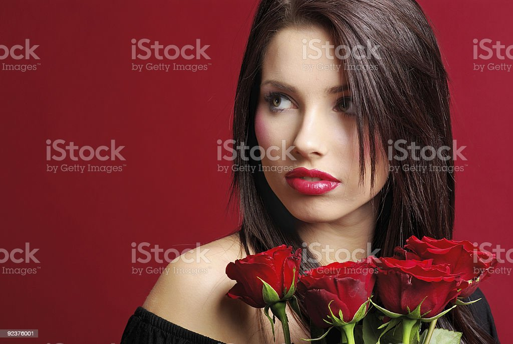 Beautiful woman with  rose.  red background royalty-free stock photo