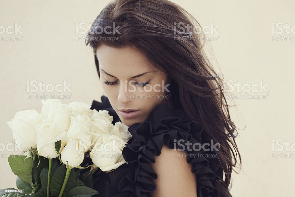 Beautiful woman with roses royalty-free stock photo