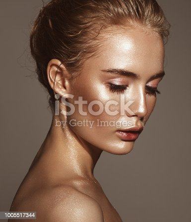Beautiful woman with shiny glitter on her face