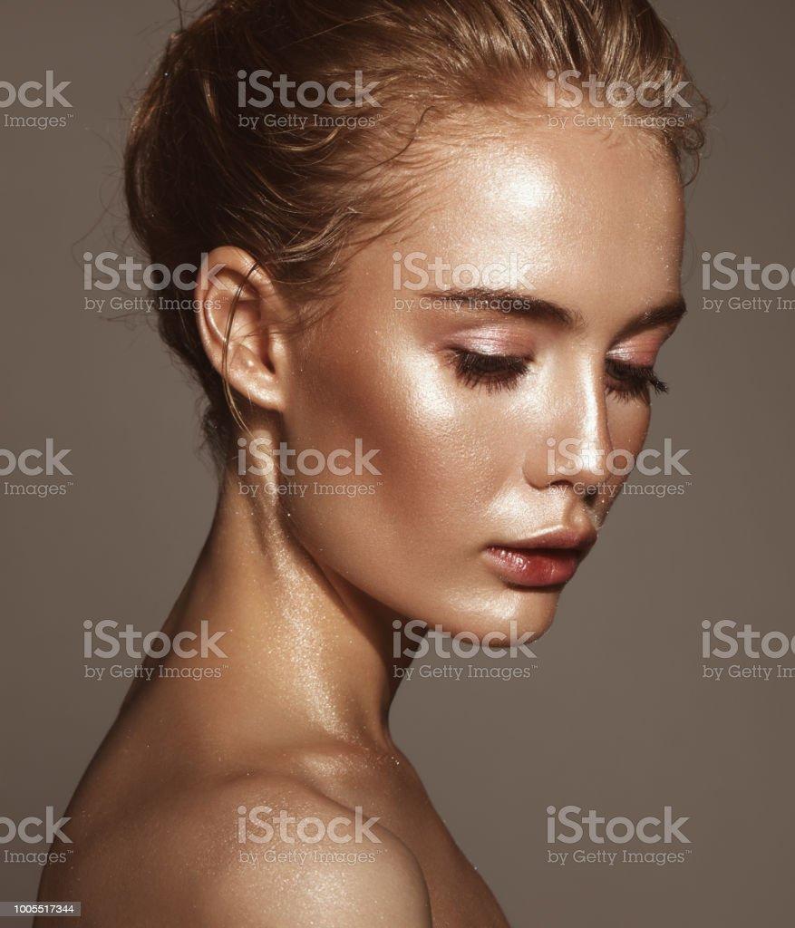Beautiful woman with shiny make-up stock photo