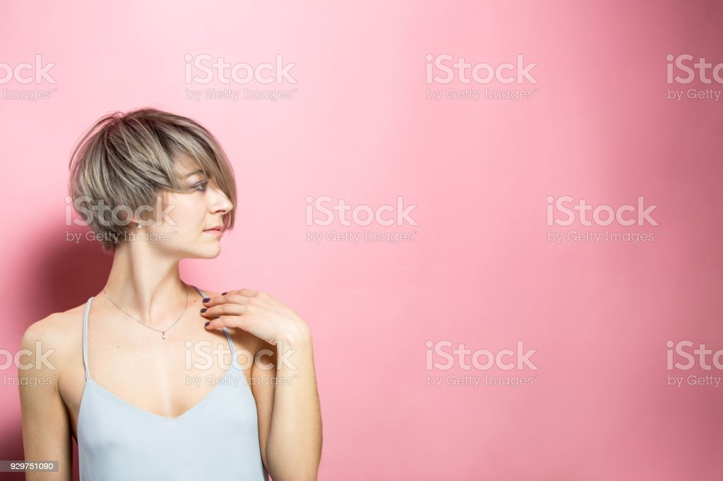 Beautiful woman with short hair and summer dress fashion beautiful young woman with short hair over pink background Adult Stock Photo