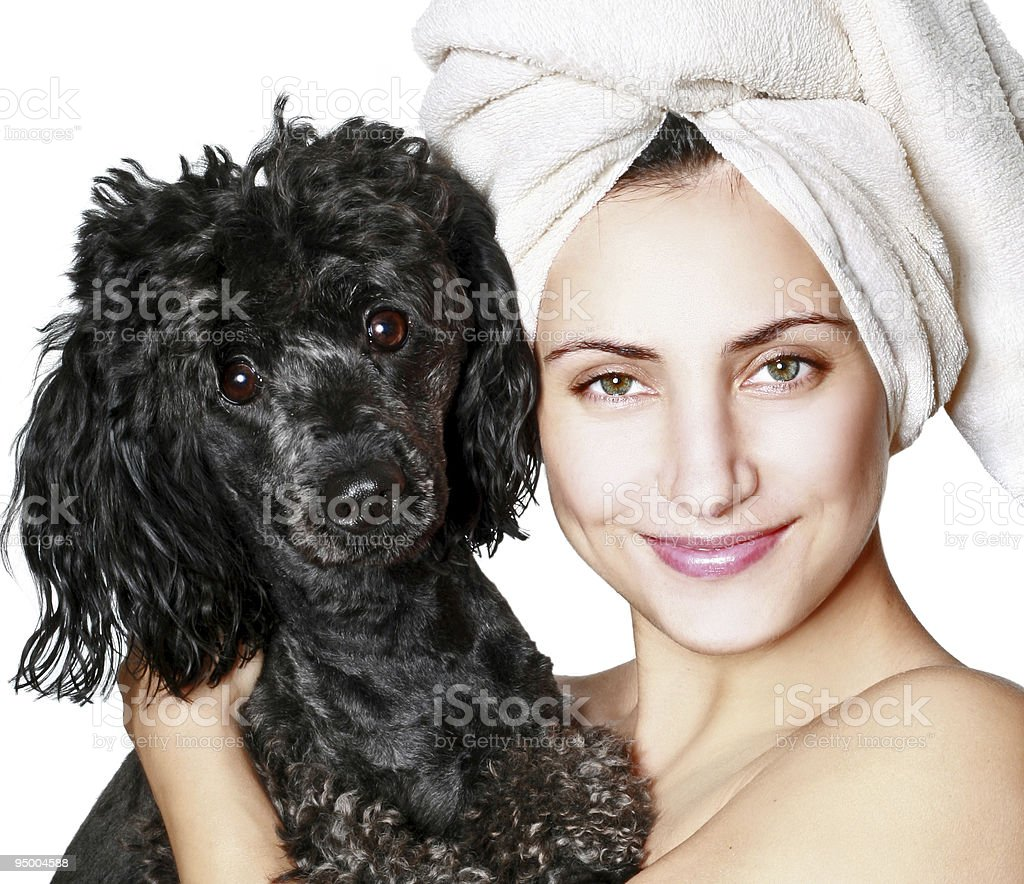 Beautiful woman with small poodle royalty-free stock photo