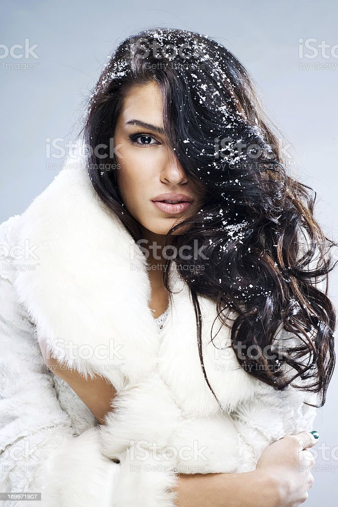 Beautiful woman with snow in her hair. royalty-free stock photo