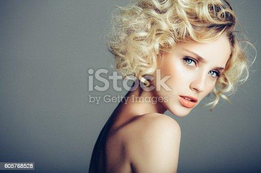 istock Beautiful woman with stylish hairstyle 605768528