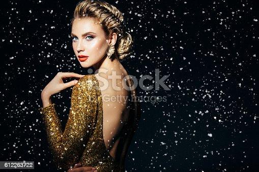 istock Beautiful woman with stylish hairstyle 612263722