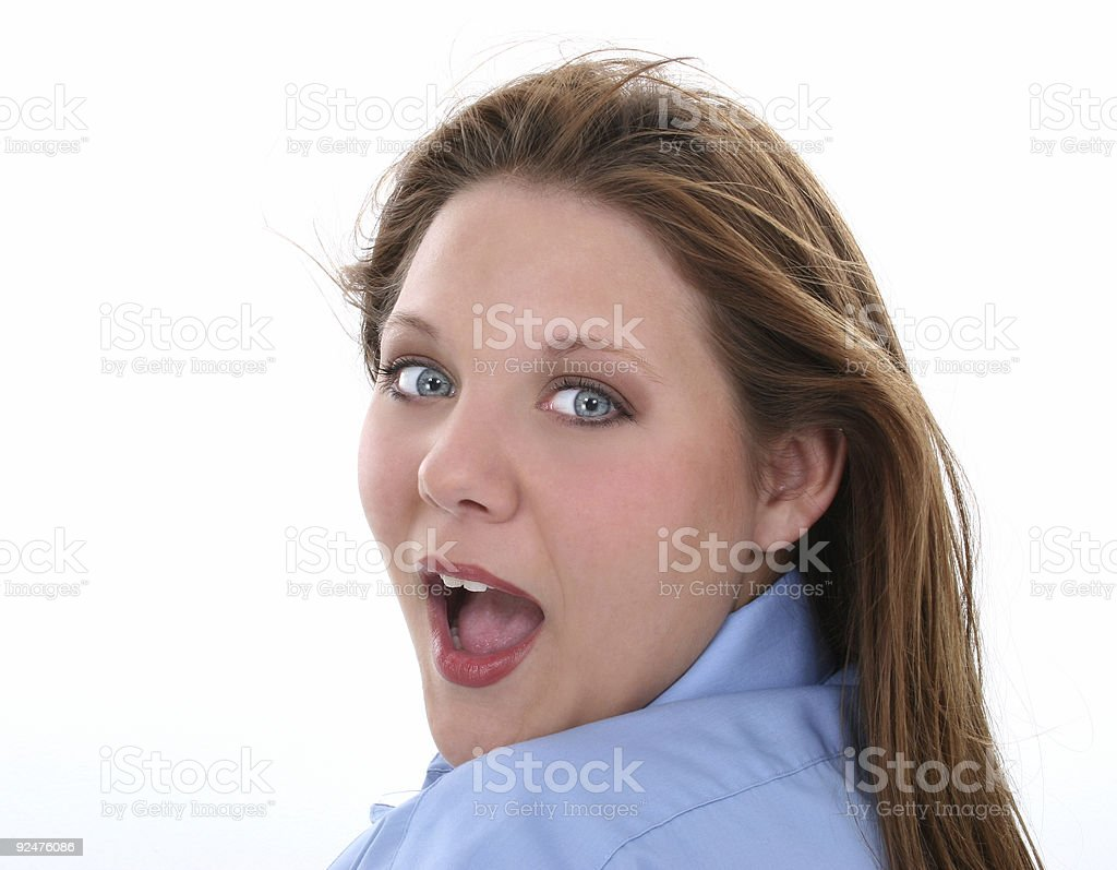 Beautiful Woman With Surprised Expression Looking Over Shoulder royalty-free stock photo