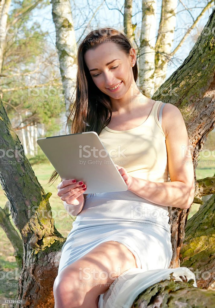 beautiful woman with tablet pc royalty-free stock photo