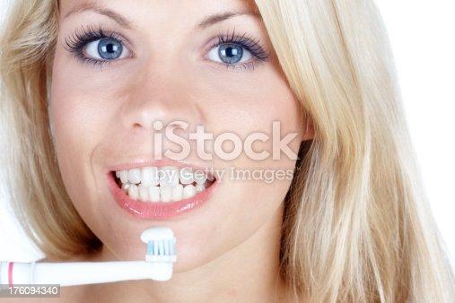 637874676istockphoto beautiful woman with toothbrush 176094340