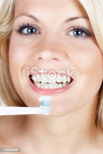 637874676istockphoto beautiful woman with toothbrush 176095667