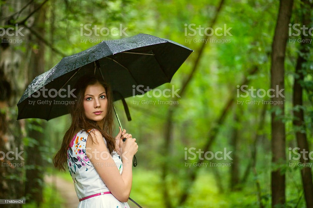 beautiful woman with umbrella royalty-free stock photo