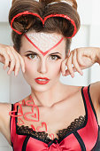 istock Beautiful woman with valentines day makeup 637743042