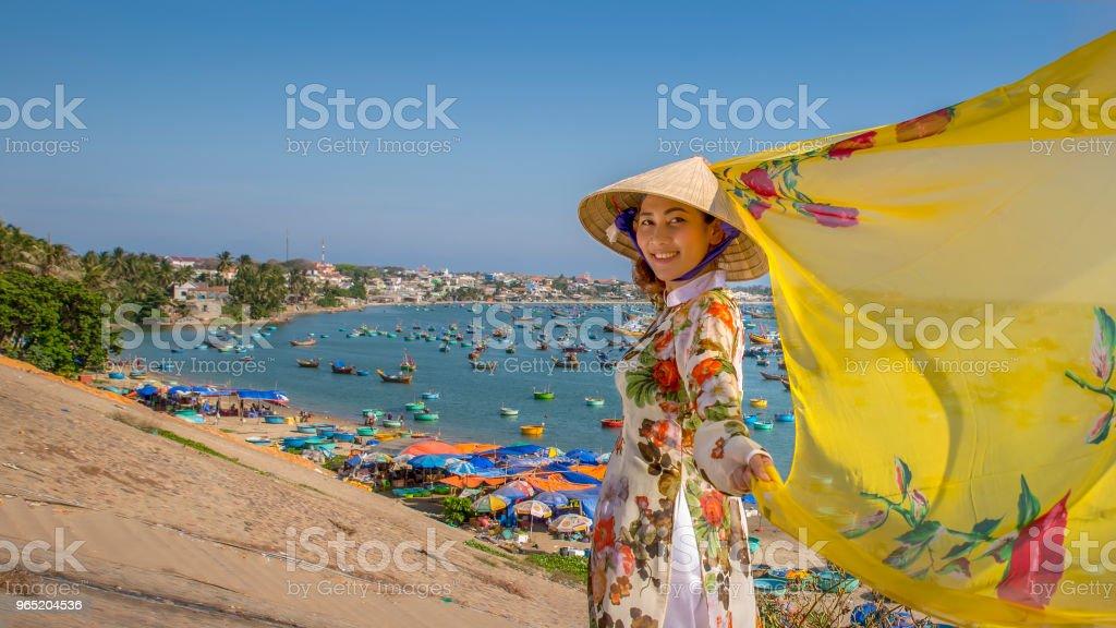 Beautiful woman with Vietnam culture traditional dress, Ao dai and holding straw hat. zbiór zdjęć royalty-free