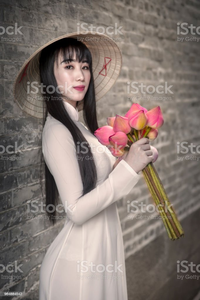 Beautiful woman with Vietnam culture traditional dress, Ao dai is famous traditional costume , Ho Chi minh Vietnam royalty-free stock photo