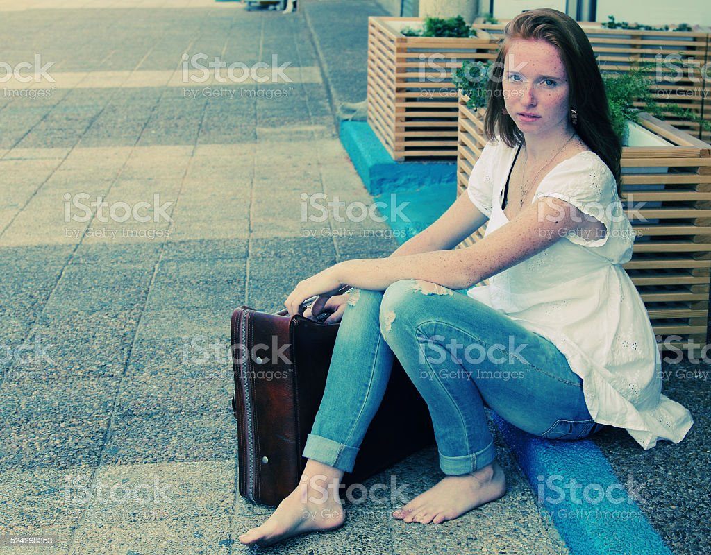 beautiful woman with vintage bag stock photo