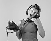 istock Beautiful woman with vintage phone. 891337922