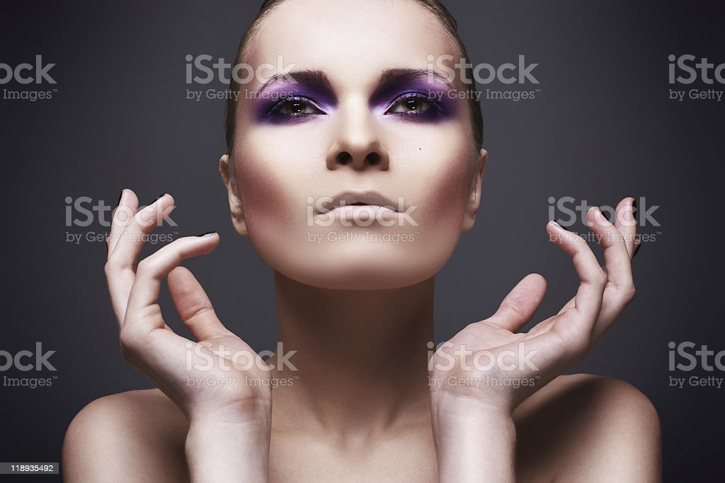 Beautiful woman with violet make-up stock photo
