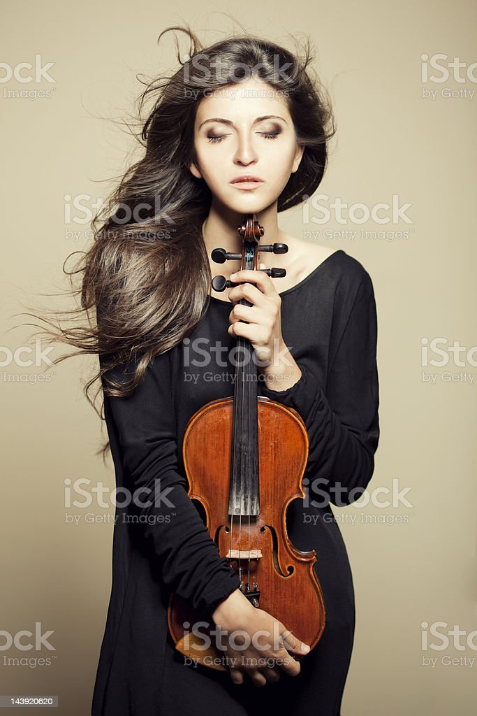 Beautiful woman with violin stock photo