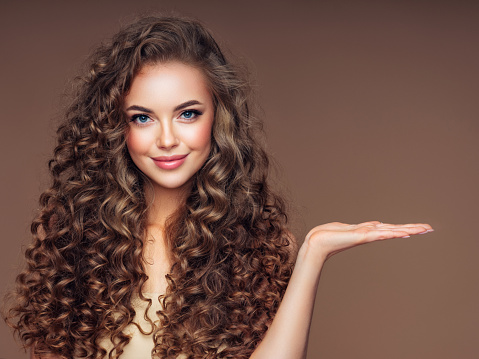 istock Beautiful woman with voluminous curly hairstyle 1187559464