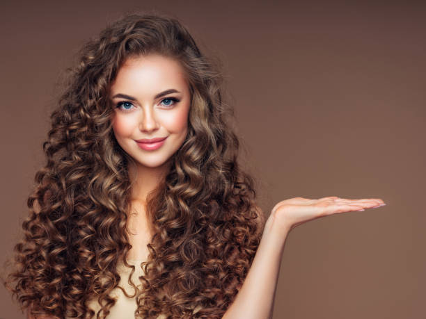 Beautiful woman with voluminous curly hairstyle stock photo