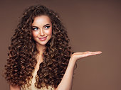 Beautiful woman with voluminous curly hairstyle