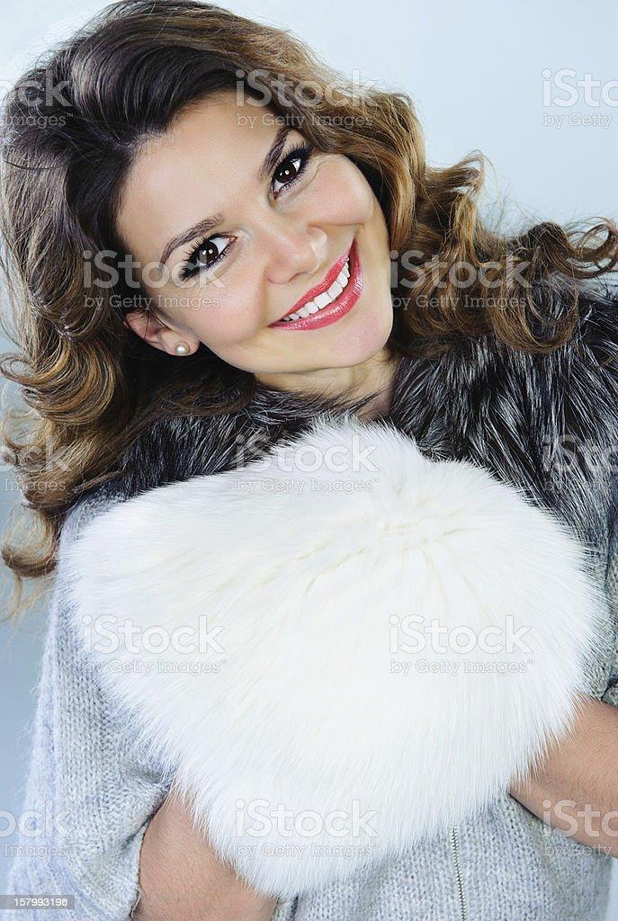 Beautiful woman with white fur muff stock photo